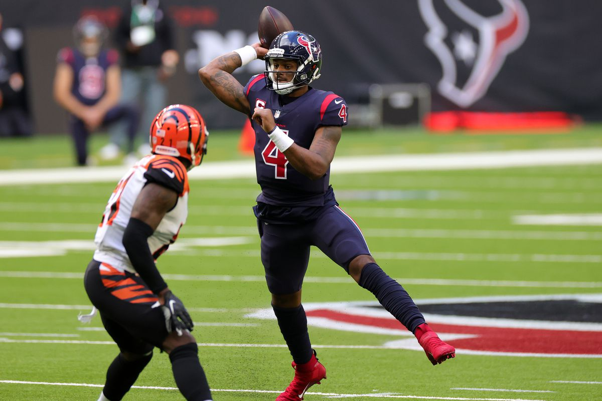 Quarterback Deshaun Watson #4 of the Houston Texans drops back to pass over the defense of the Cincinnati Bengals during the game at NRG Stadium on December 27, 2020 in Houston, Texas.