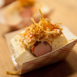 A tasting portion of the Barking Dog - bacon-wrapped hot dog, garden relish, cheese sauce, crispy onions