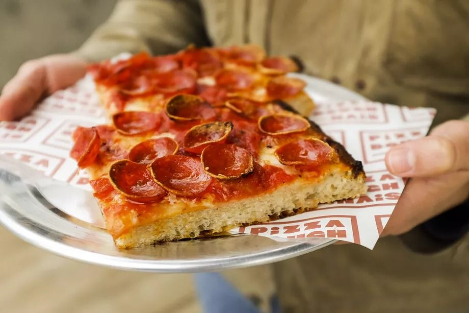 A picture of two pepperoni squares with thick crusts at Pizza Doughnais