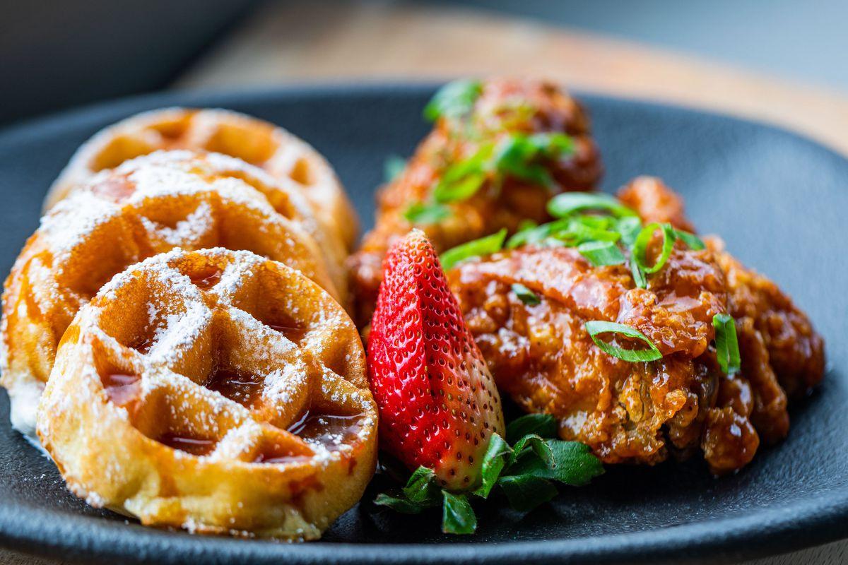 mini waffles with glazed fried chicken at taste bar & kitchen