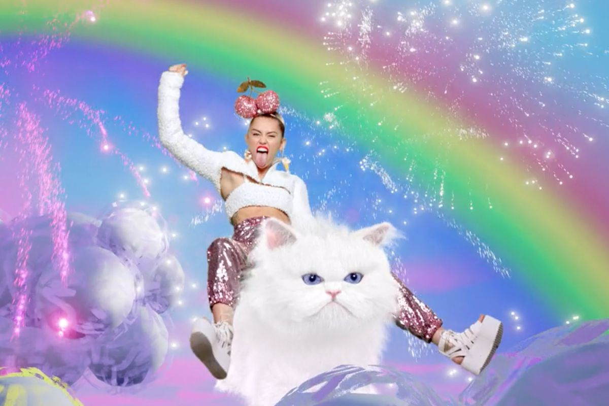 """<a href=""""http://www.wmagazine.com/people/celebrities/2015/08/miley-cyrcus-mvt-vma-awards-cat-video/"""">By Pamela Reed and Matthew Rader</a>"""