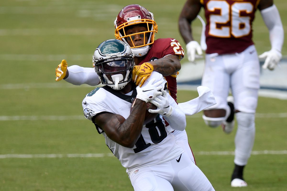 Jalen Reagor #18 of the Philadelphia Eagles makes a catch against Ronald Darby #23 of the Washington Football Team in the first quarter at