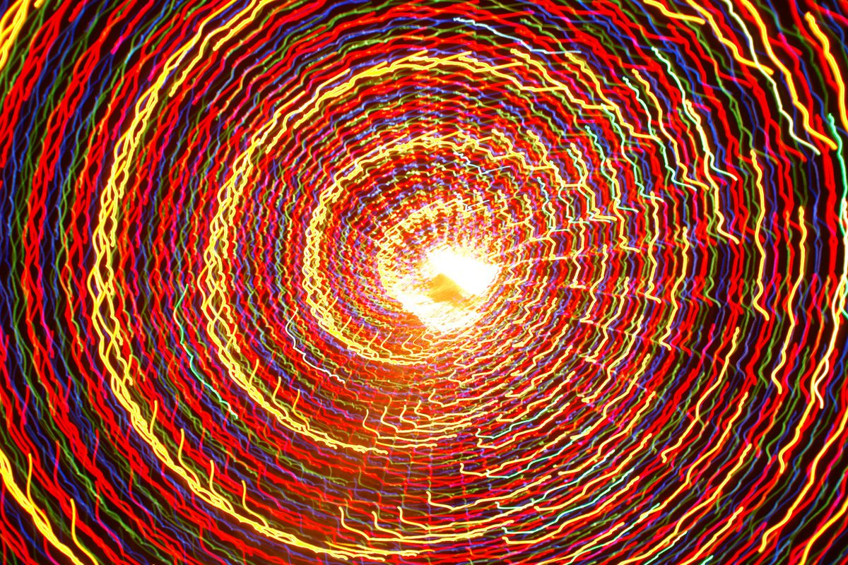 A funnel of lights moving upward while photog spins below