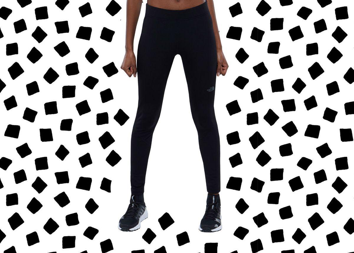 A model in black North Face leggings