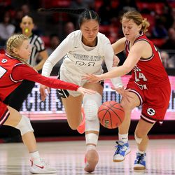 Highland's Sosefina Langi splits the defense of Springville's Ahna Hullinger and Blythe Stoddard as they play in the 5A State Basketball Championship in the Huntsman Center at the University of Utah in Salt Lake City on Saturday, Feb. 29, 2020. Highland won 46-34.