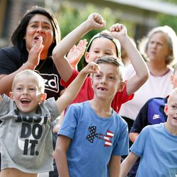 The Peterson family, of Pleasant Grove, cheers on Andrew Peterson as he competes in the Deseret News Half Marathon in Salt Lake City on Friday, July 23, 2021.