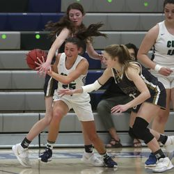 Syracuse's Baylee Sanders pulls down a rebound between Davis' Kendra Kitchen, left, and Morgan Burnett during a game at Syracuse High School on Tuesday, Feb. 9, 2021.