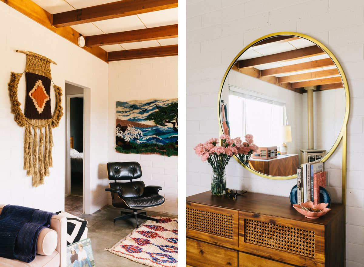 The house sits in a desert landscape complete with cacti and Joshua trees; the living room has polished concrete floors and 1970s-era wallhangings; a round brass-framed mirror reflects the living room.