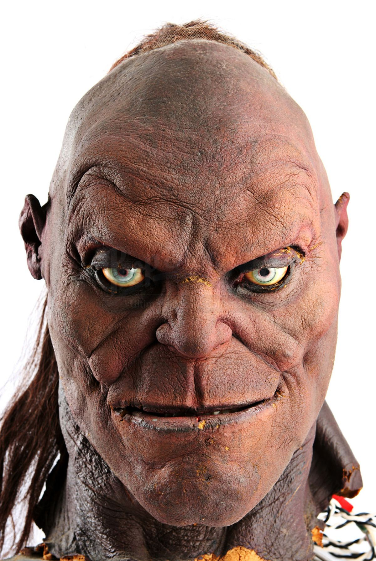 a front shot of a prop of the head of Goro from Mortal Kombat