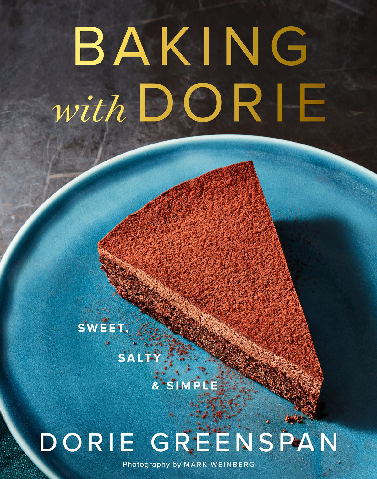 """A cookbook cover with a slice of chocolate cake and the title """"Baking With Dorie"""""""
