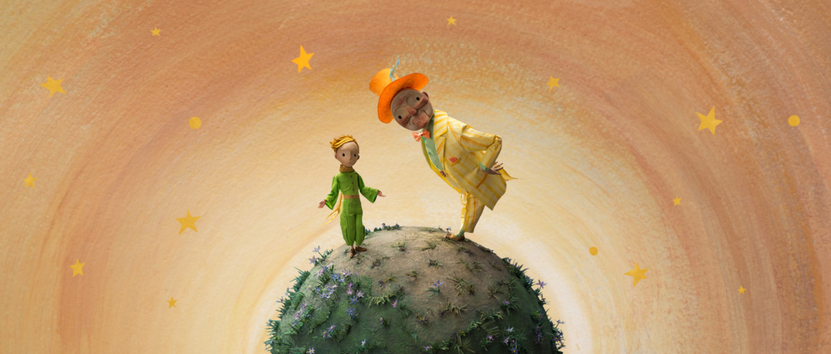 The little prince standing on a planet.