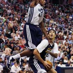 Jeremy Evans fouls Enes Kanter during the Utah Jazz's scrimmage in Salt Lake City on Saturday, Oct. 5, 2013.