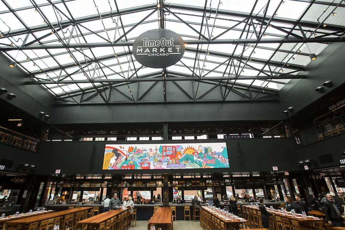 Time Out Market's space features multiple food vendors, a full-service bar, and a massive skylight.