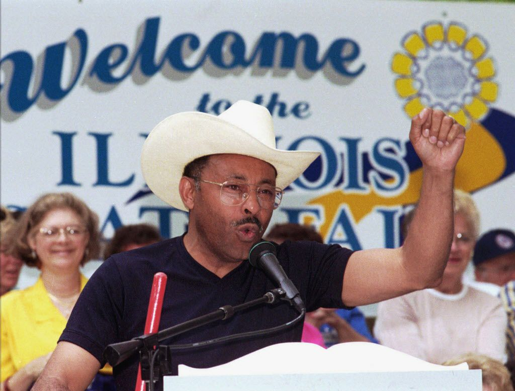 Democrat Roland Burris addresses a crowd at a rally during Democrat Day at the Illinois State Fair in Springfield in 1997. File Photo. (AP Photo/Randy Squires, File)