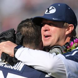 Brigham Young Cougars head coach Bronco Mendenhall hugs Brigham Young Cougars place kicker Trevor Samson (27) as seniors are honored prior to the game against Fresno in Provo Saturday, Nov. 21, 2015. BYU won 52-10.