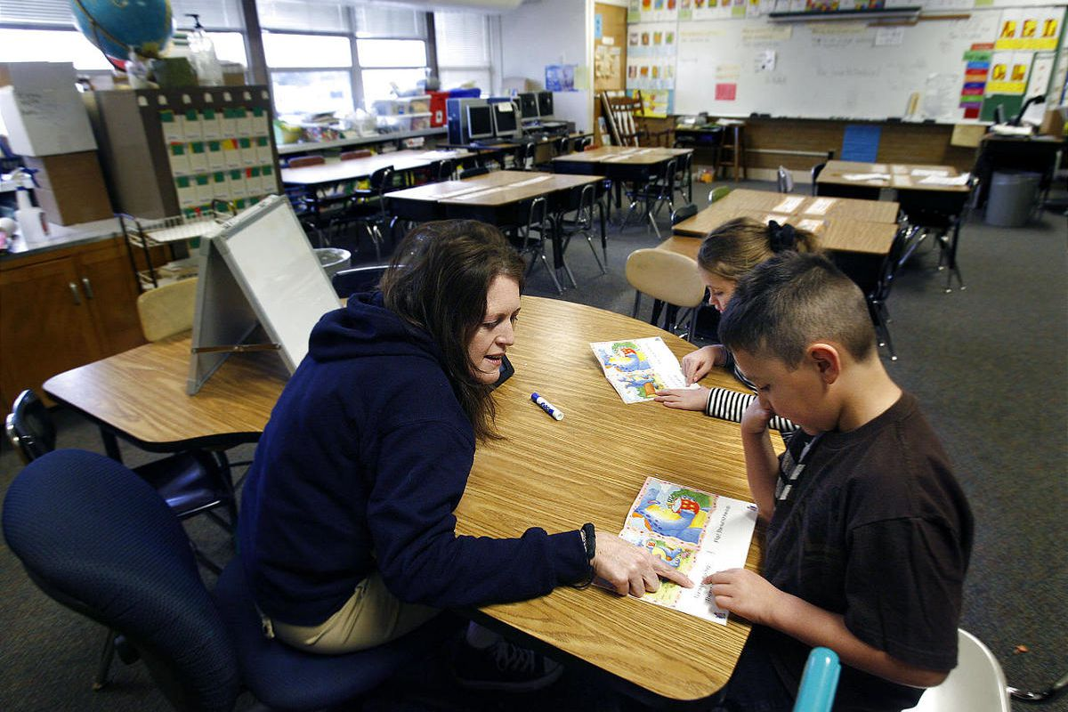 Reading Specialist DeAnne Wilie works with second graders Alejandro Flores and Olivia Baarsma at Hillsdale Elementary School in West Valley City on Friday, January 20, 2012.