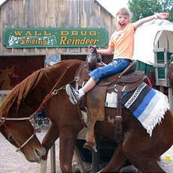 Emma Kratz, 6, plays in the children's area in front of Wall Drug, which offers free ice water.