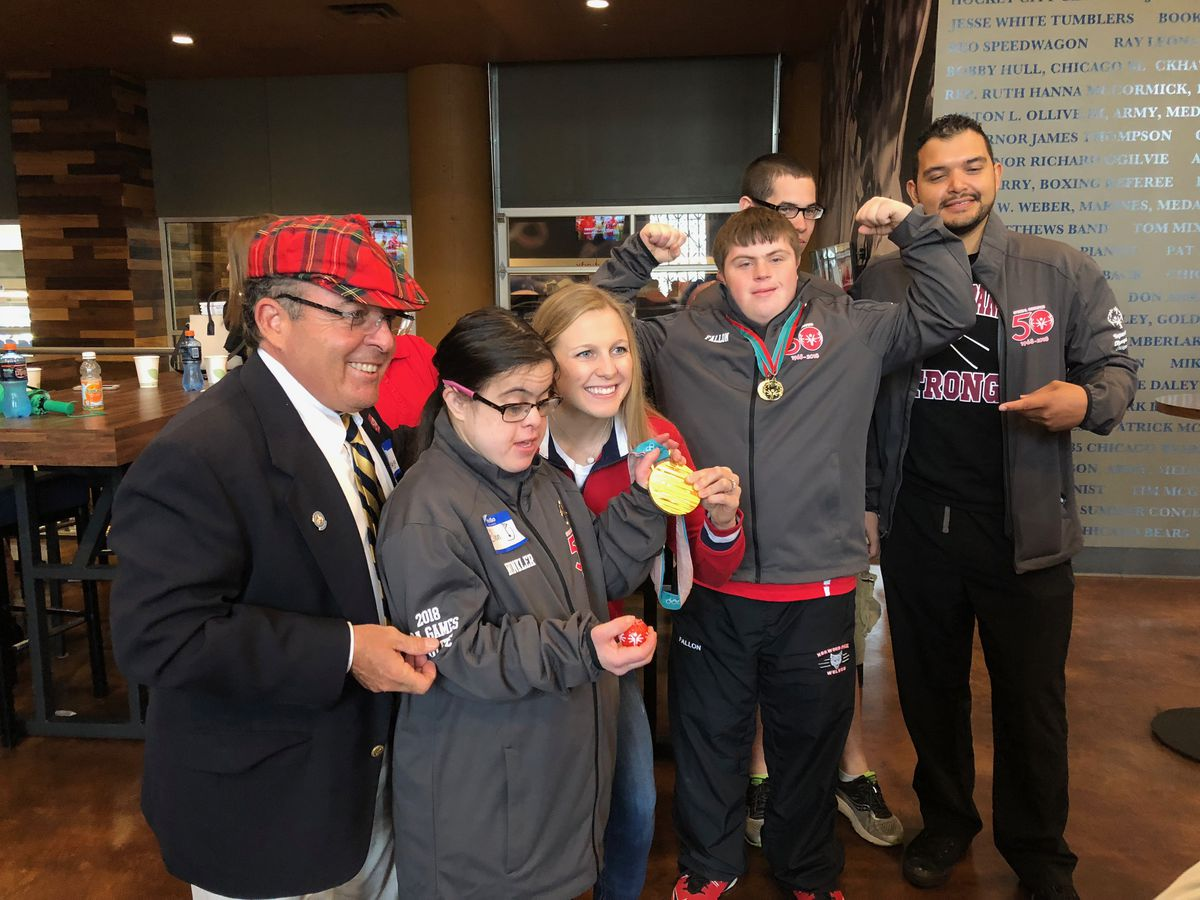 Kendall Coyne posed with a group of Special Olympic athletes before the opening ceremonies.   Madeline Kenney/Sun-Times