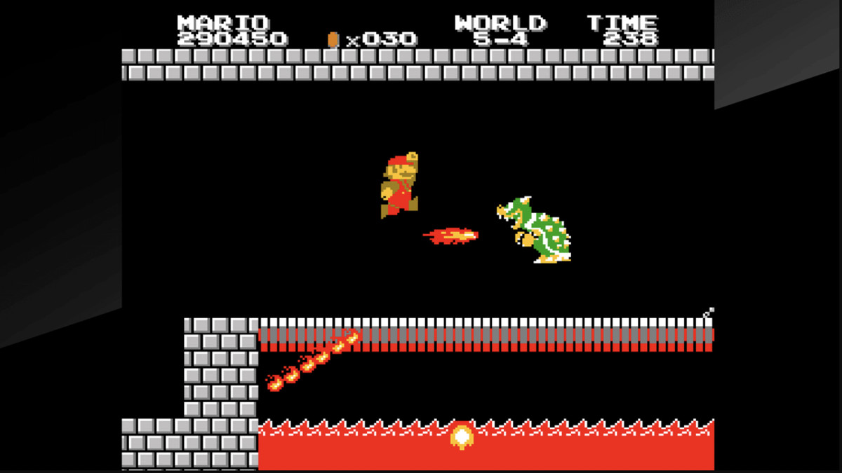 Mario attempts to jump over Bowser's fireball in Vs. Super Mario Bros.