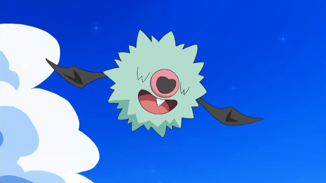 A Woobat flies in the sky