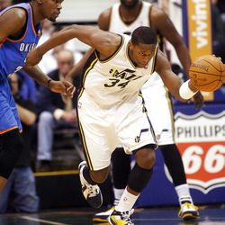 Utah Jazz forward C.J. Miles (34) pushes the ball up court after taking it away from Oklahoma City's #35 Kevin Durant as the Utah Jazz play the Oklahoma City Thunder Tuesday, March 20, 2012 in Salt lake City.