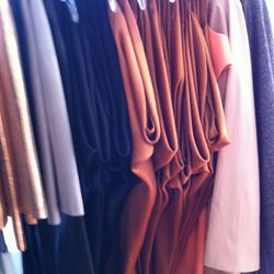 $550 for the copper and black slinky mini-dresses