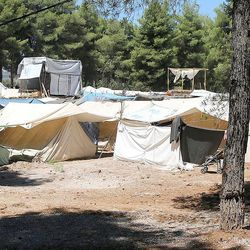 Refugees live in military-issue tents at the Ritsona refugee camp near Athens, Greece, in July 2016.