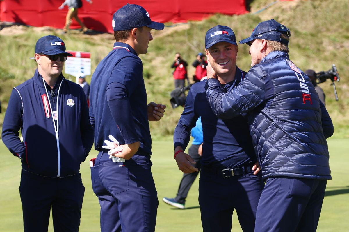 Justin Thomas of team United States, Jordan Spieth of team United States, and captain Steve Stricker of team United States celebrate on the 18th green during Saturday Morning Foursome Matches of the 43rd Ryder Cup at Whistling Straits on September 25, 2021 in Kohler, Wisconsin.