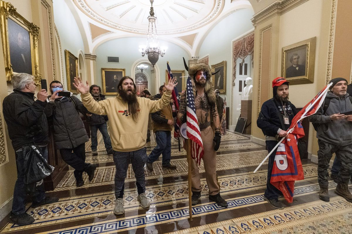In this Wednesday, Jan. 6, 2021 file photo supporters of President Donald Trump are confronted by U.S. Capitol Police officers outside the Senate Chamber inside the Capitol in Washington.