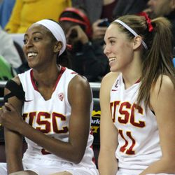 Desiree Bradley & Cassie Harberts laugh on the bench at the end of a blowout win.