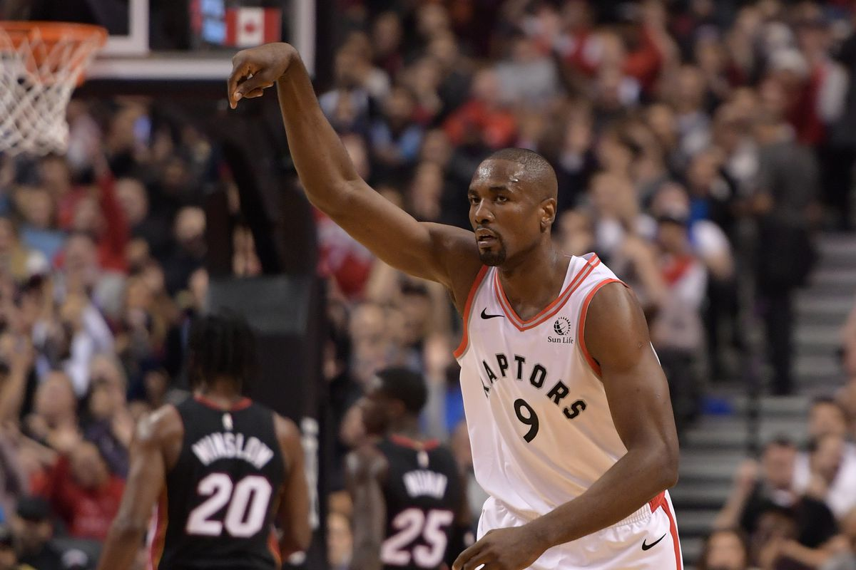 Toronto Raptors center Serge Ibaka reacts after scoring against Miami Heat in the first half at Scotiabank Arena.