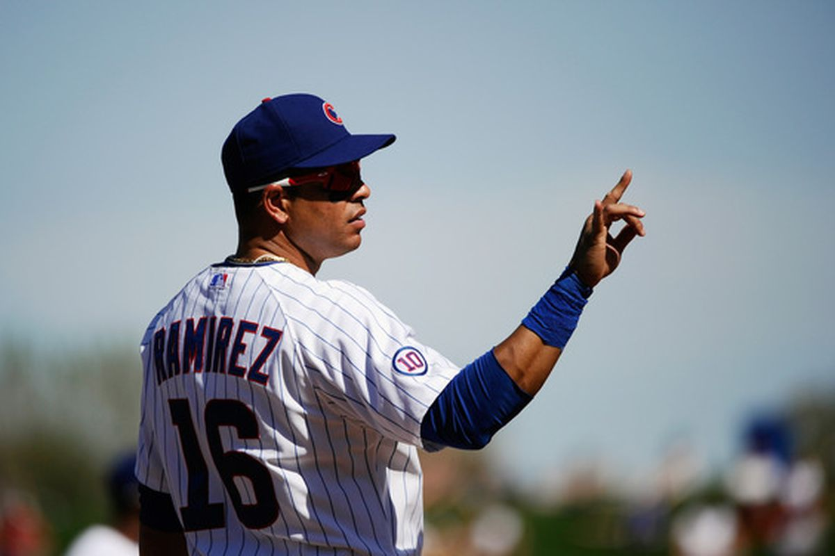 Aramis Ramirez of the Chicago Cubs signals two outs during the spring training baseball game against the Kansas City Royals at HoHoKam Stadium in Mesa, Arizona.  (Photo by Kevork Djansezian/Getty Images)