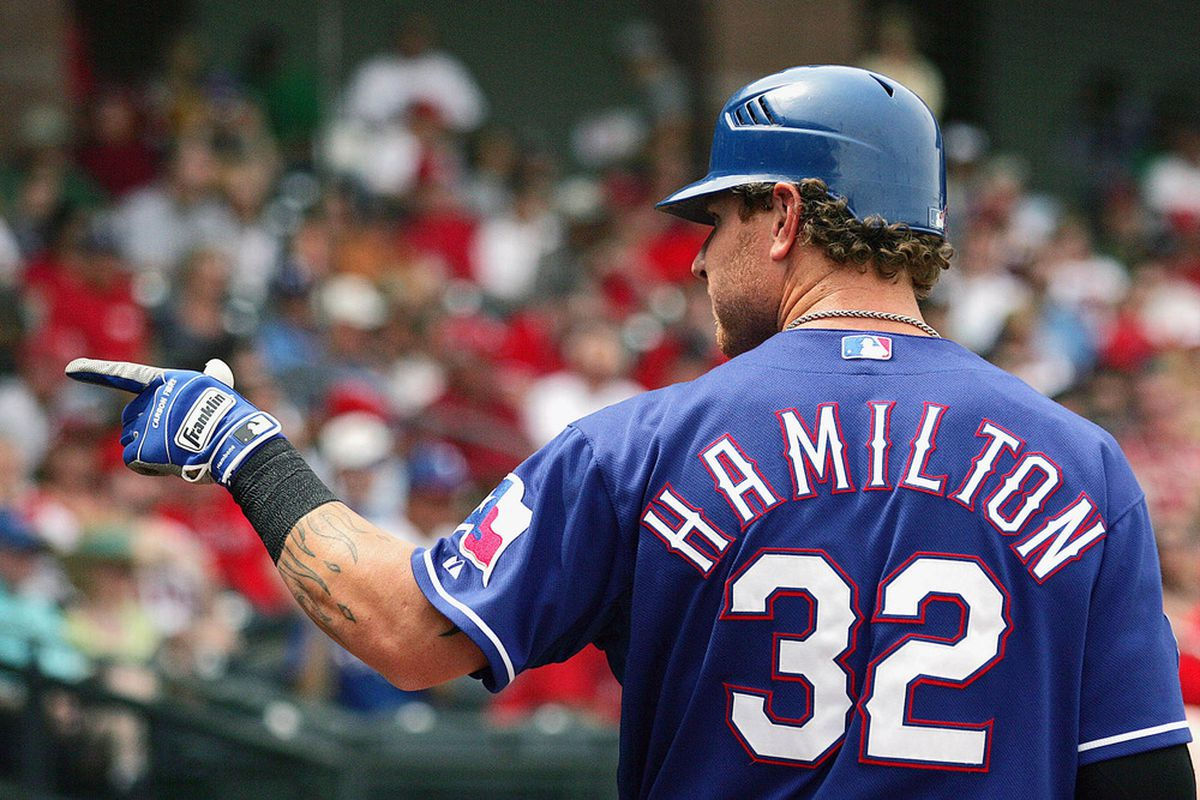 Mar 24, 2012; Surprise, AZ, USA; Texas Rangers left fielder Josh Hamilton (32) points to the stands before an at bat during the first inning against the Los Angeles Angels at Surprise Stadium.  Mandatory Credit: Jake Roth-US PRESSWIRE