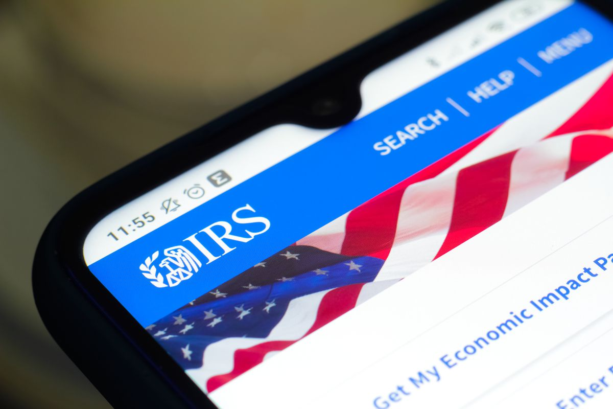 In this photo illustration the Internal Revenue Service (IRS) logo seen displayed on a smartphone.
