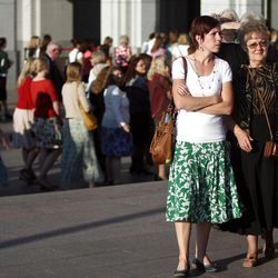 Women arrive at the General Relief Society Meeting at the Conference Center on Temple Square in Salt Lake City on Saturday, Sept. 29, 2012.