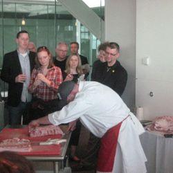 Butcher Jason Belleau cutting up a pig.
