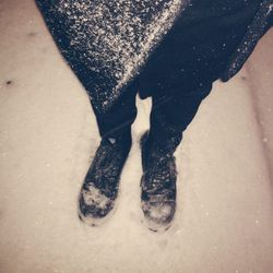It's snowing pretty hard on my walk home. I've got two pairs of socks on underneath these bad boys. And by bad boys, I mean steel-toed <b>Doc Martens</b>. I don't mess around.