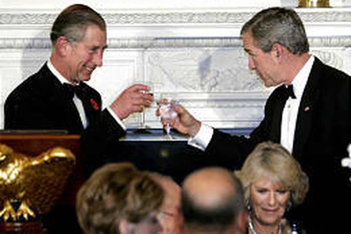 President Bush makes a toast with Prince Charles at White House. Camilla, Duchess of Cornwall, is in front of Bush.