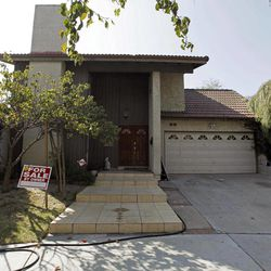 """This Tuesday, Sept. 25, 2012, photo shows a """"For Sale"""" sign at the home of Nakoula Basseley Nakoula, the man who made the film """"Innocence of Muslims"""" that has sparked violent protests, on a street in Cerritos, Calif. The filmmaker has received death threats and was forced into hiding after the 14-minute movie trailer rose to prominence."""