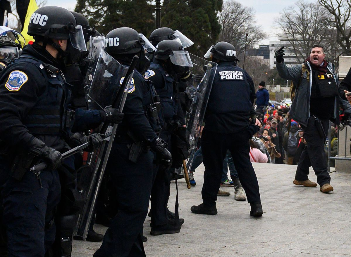 Trump supporters face off with police and security forces in front of the US Capitol on Wednesday.