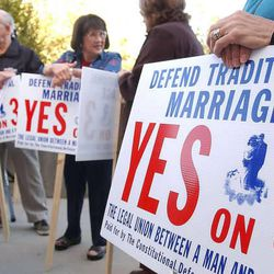 """In this 2004 file photo, people attend a Provo rally in support of Amendment 3. U.S. District Judge Robert Shelby struck down Utah's Amendment 3 """""""" which defines traditional marriage as the union of a man and a woman"""""""" Friday, finding that it violates rights to due process and equal protection as set forth in the 14th Amendment."""