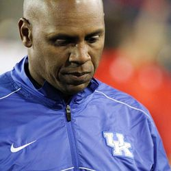 Kentucky head coach Joker Phillips walks off the field after losing to Western Kentucky 32-31 in overtime of an NCAA college football game at Commonwealth Stadium in Lexington, Ky., Saturday, Sept. 15, 2012.