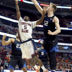 Illinois guard Jalen Coleman-Lands (5) shoots over BYU forward Eric Mika (12) during the first half of an NCAA college basketball game Saturday, Dec. 17, 2016, in Chicago. (AP Photo/Nam Y. Huh)