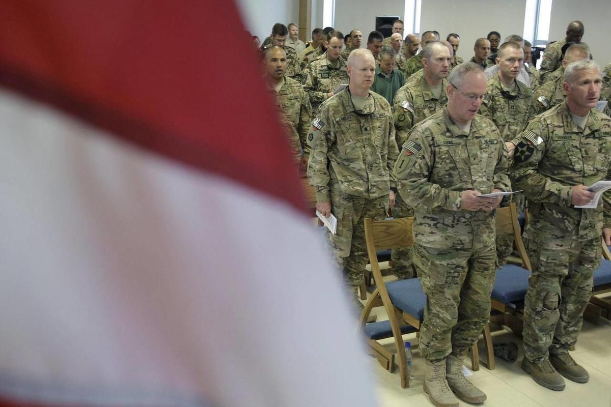 U.S. soldiers and NATO service members attend a ceremony marking the 11th anniversary of the Sept. 11 attacks that killed almost 3,000 in the United States, at NATO camp Kaia in Kabul, Afghanistan, Tuesday, Sept. 11, 2012.