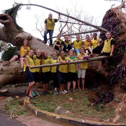 Women serving in the Puerto Rico San Juan Mission take a break from removing fallen trees from streets and yards after Hurricane Maria last week in BayamÓn, Puerto Rico.