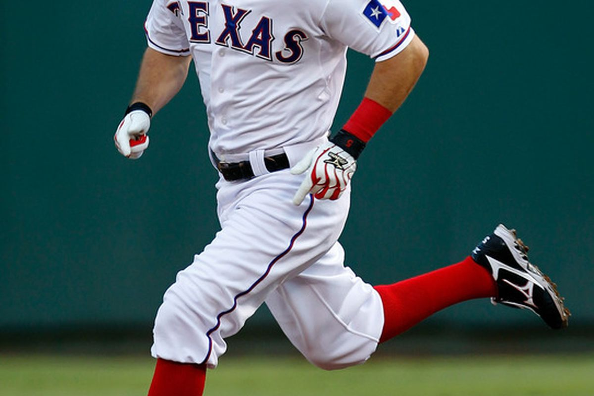 ARLINGTON, TX - JULY 25:  Ian Kinsler #5 of the Texas Rangers rounds first base after hitting a double against the Minnesota Twins at Rangers Ballpark in Arlington on July 25, 2011 in Arlington, Texas.  (Photo by Tom Pennington/Getty Images)