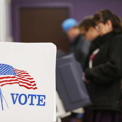 Voters cast their vote at Evergreen Library in Salt Lake County Tuesday, Nov. 4, 2014.
