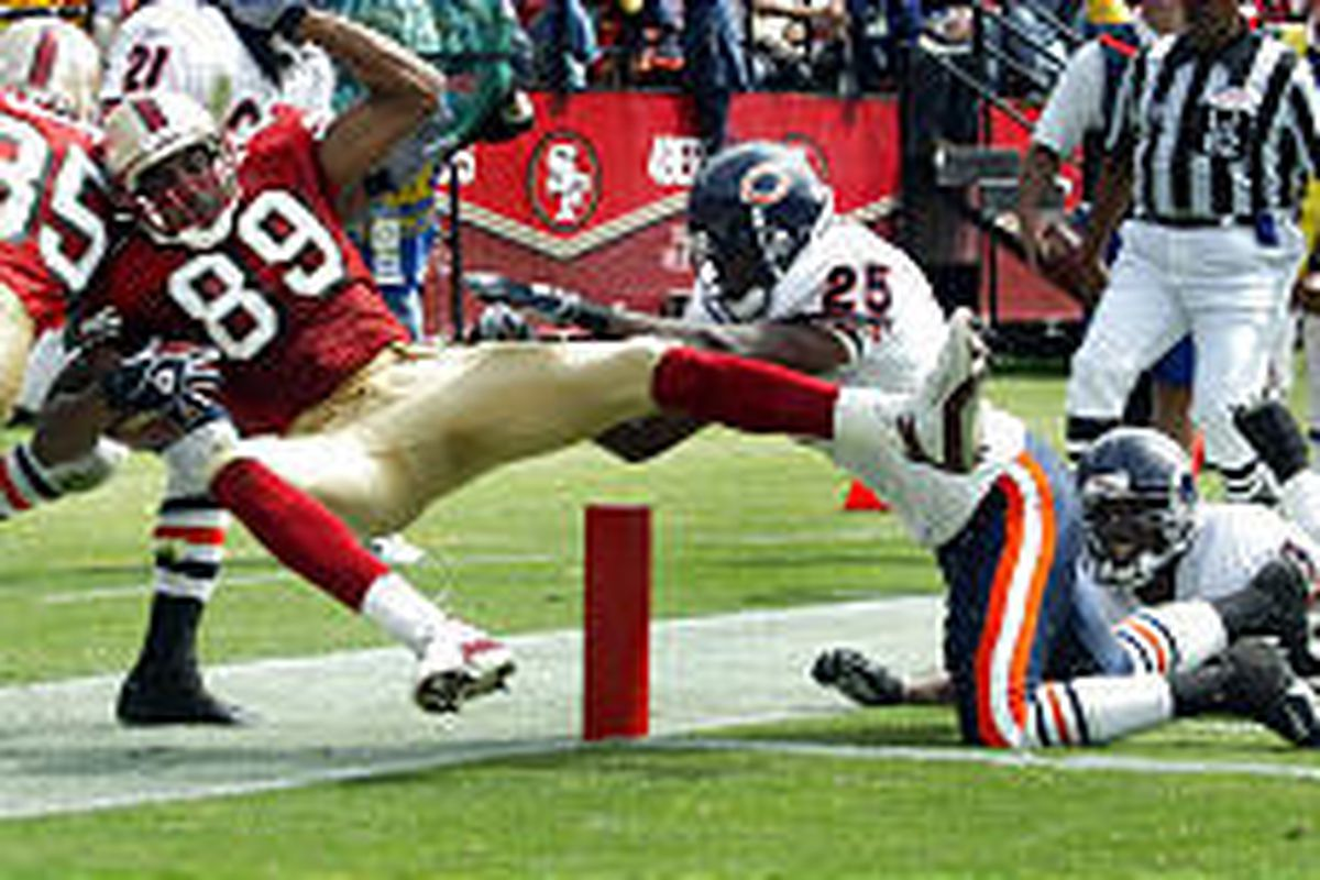 San Francisco's Tai Streets (89) takes a short pass for a touchdown while getting knocked out of the end zone by the Bears' Bobby Gray (25) in Sunday's game.