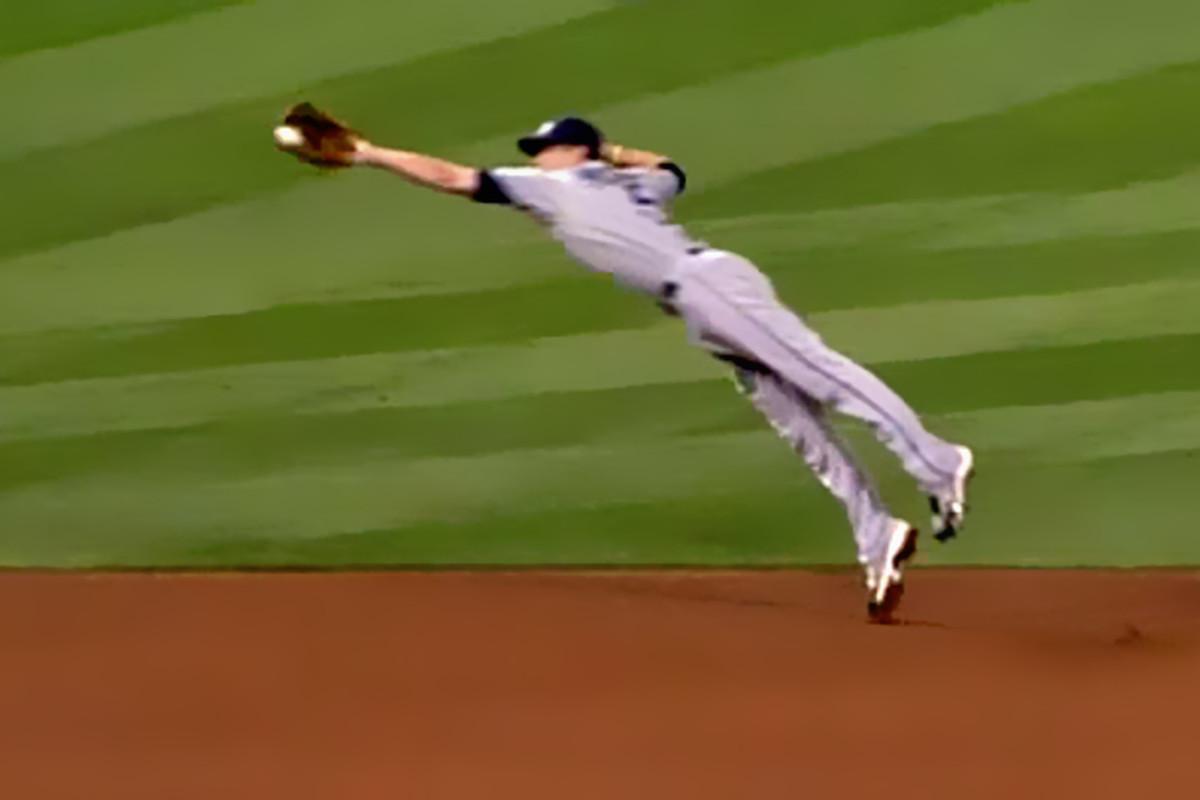 Reid Brignac makes a leaping grab, robbing Vernon Wells of a hit.
