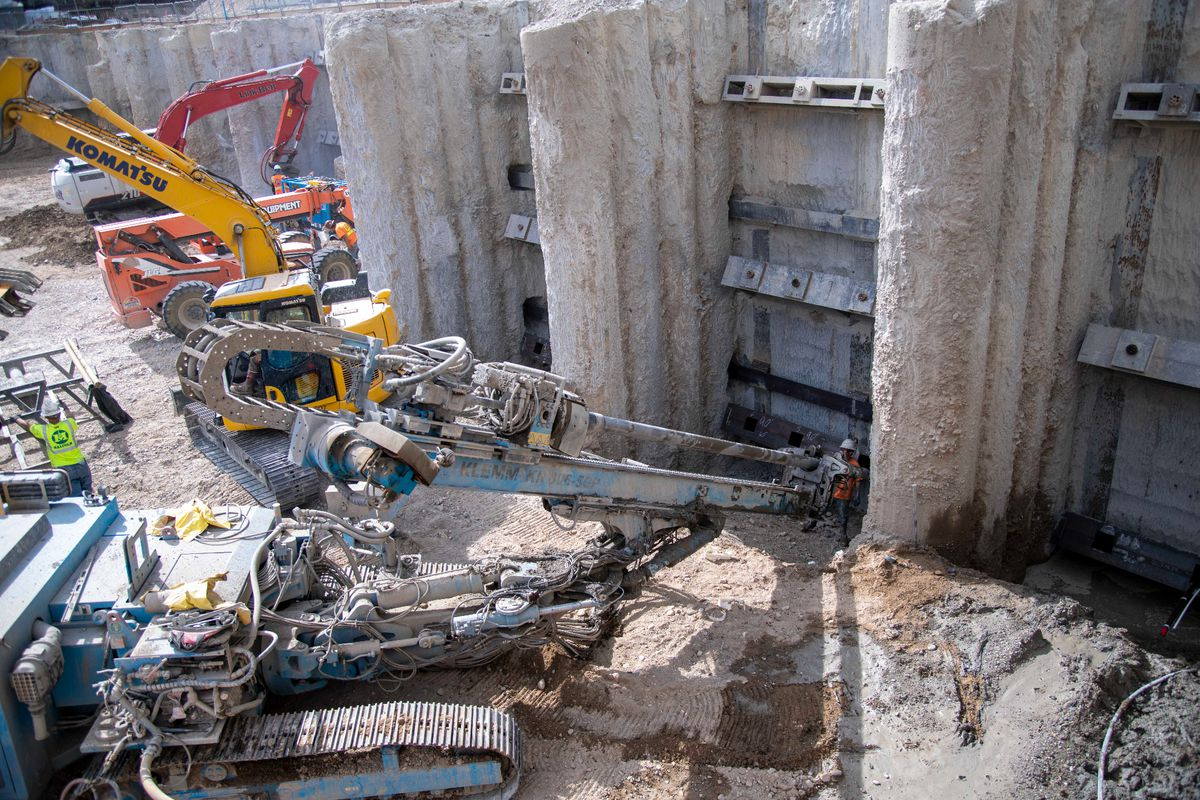 Crews prepare the foundation of the Salt Lake Temple for further excavation.
